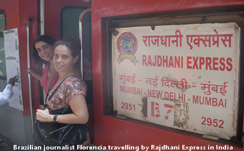 Florencia Costa and her friend Maria boarding the Rajdhani Express in India.