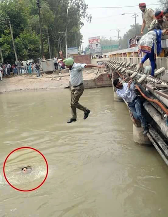 Punjab Police DSP jumping into Sirhind Canal to save a drowning woman.