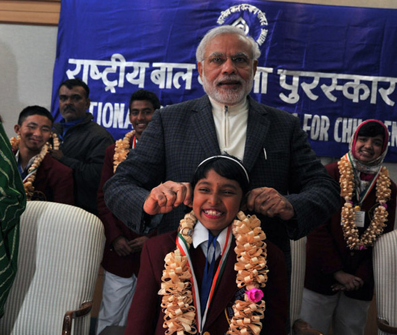 Modi's ear-pulling at a children's awards function.