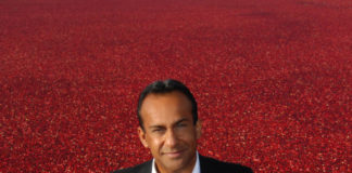 Peter Dhillon with his cranberry crop in Richmond, British Columbia.