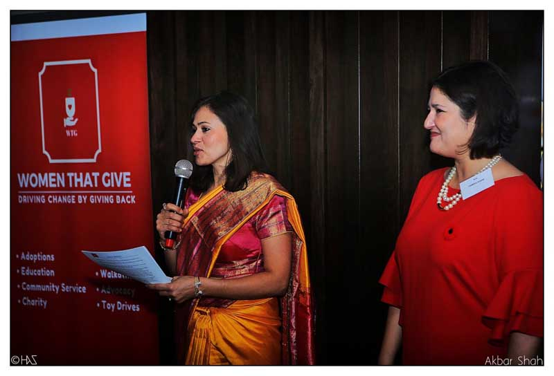 Wife of Indian consul general Dinesh Bhatia speaking at an event by Women That Give