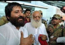 Godman Asaram Bapu with his son.
