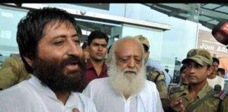 Godman Asaram Bapu with his son.