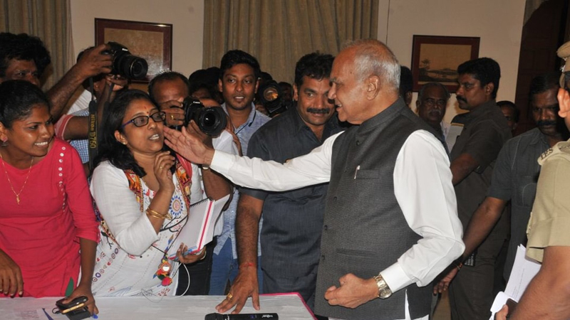 Tamil Nadu governor Banwarilal Purohit pats woman journalist on cheek
