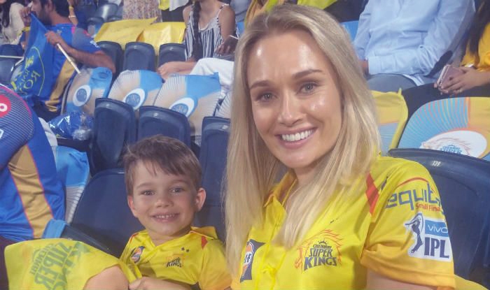 Shane Watson's wife and son in the jersey of his team Chennai Super Kings.