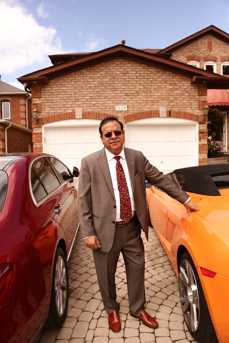 Kuldeep Sharma in front of his house.