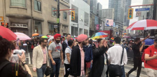 Navdeep Bains walks in Toronto Pride parade