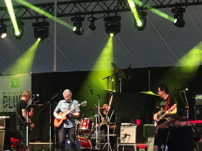Rik Emmett and his band at Kitchener Blues