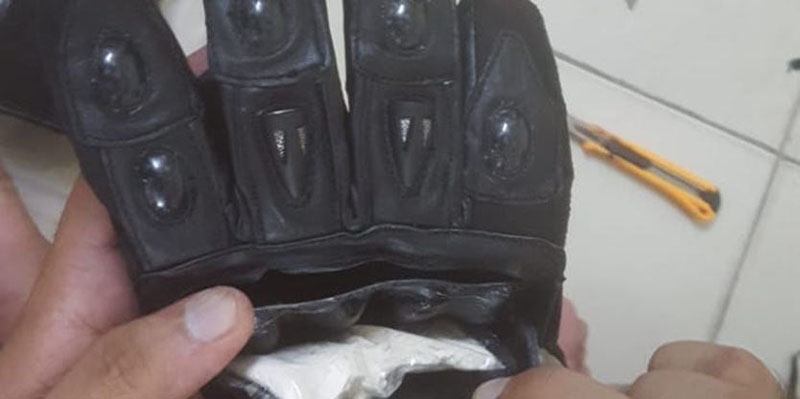 1.4 kilograms of heroin concealed in motorcycle gloves seized from the drug smuggling gang