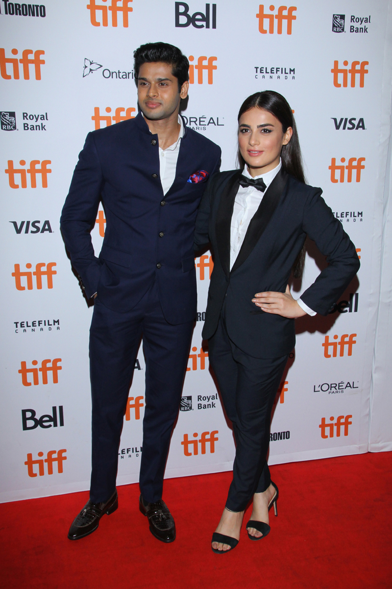 "Abhimanyu Dasani and Radhika Madan at the premiere of ""The Man Who Feels No Pain."" Photo by Jeremy Chan/Getty Images."