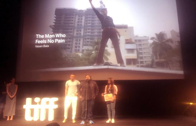 Vasan Bala and Radhika Madan accepting TIFF award