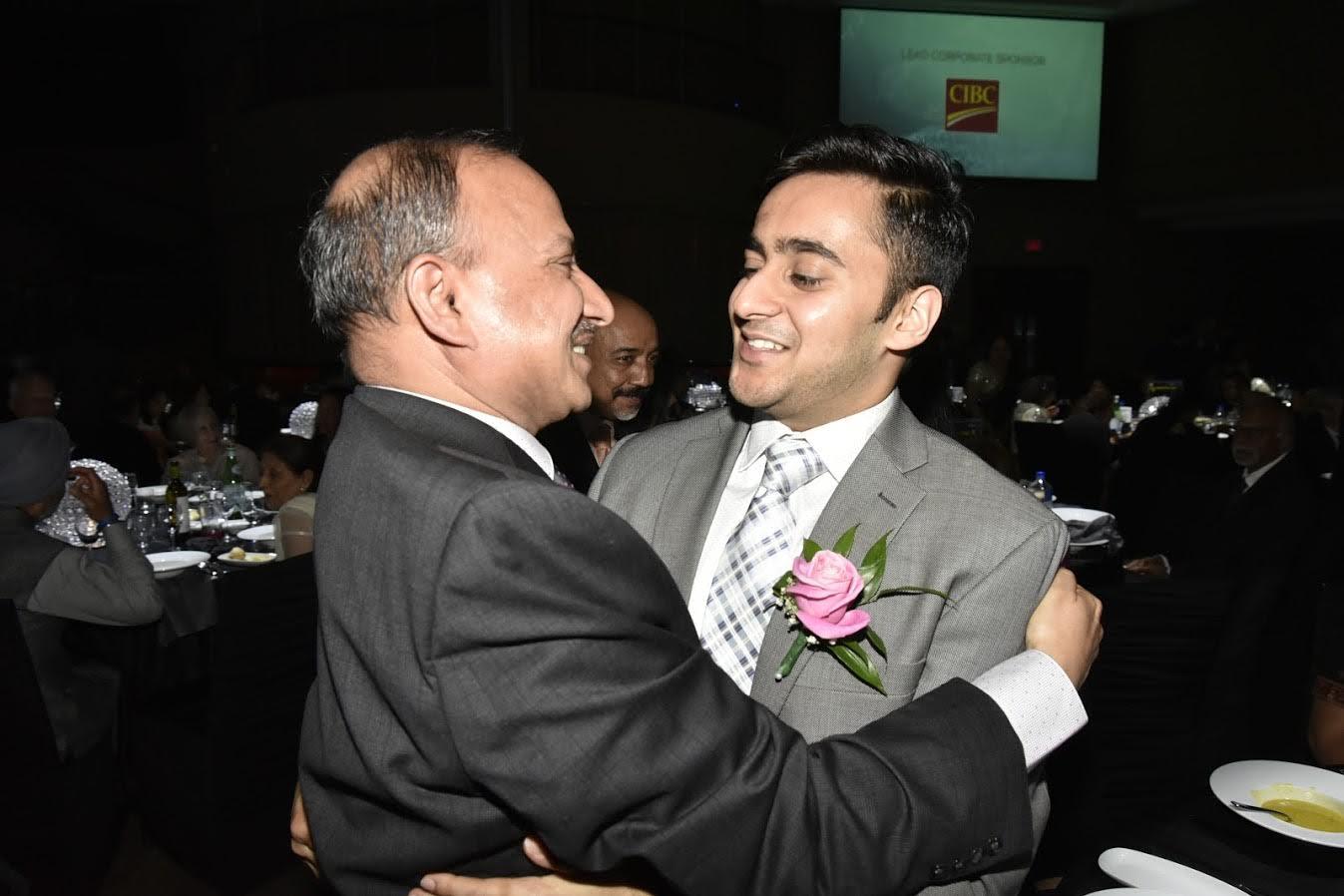 Abhishek Jain gets a hug from his father D.P. Jain on winning the ICCC award.