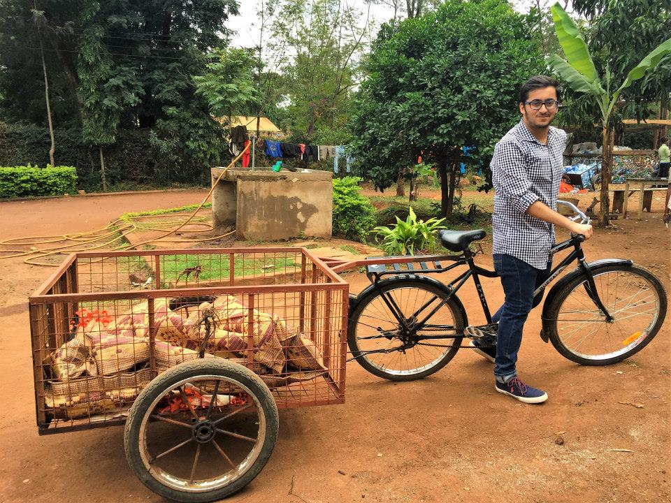 Abhishek driving the plastic pick-up bicycle in Tanzania during their plastic waste management project in the African country.