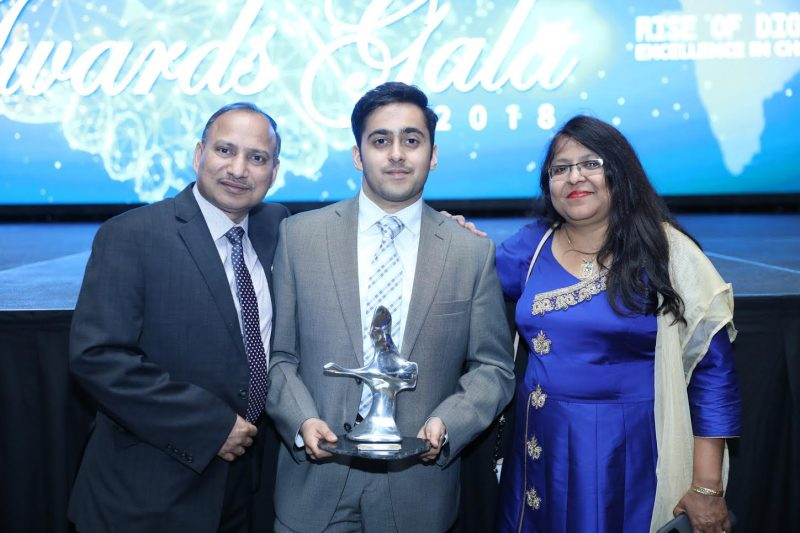 Abhishek Jain poses with his parents after winning the ICCC award.